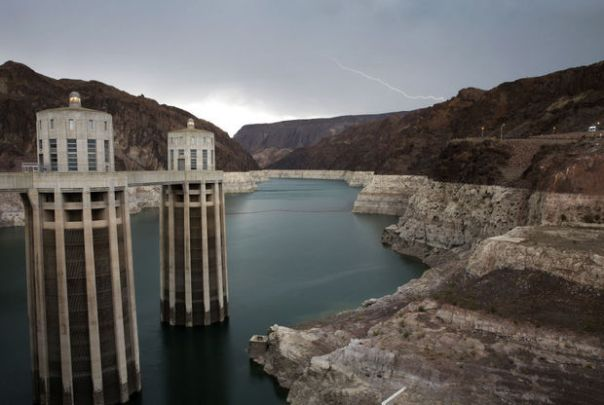 Lake Mead, with the Arizona intake towers of Hoover Dam, has shrunk to its lowest point since being filled with the Colorado River in the 1930s. The light ring shows the high water mark. John Locher / The Associated Press 2014